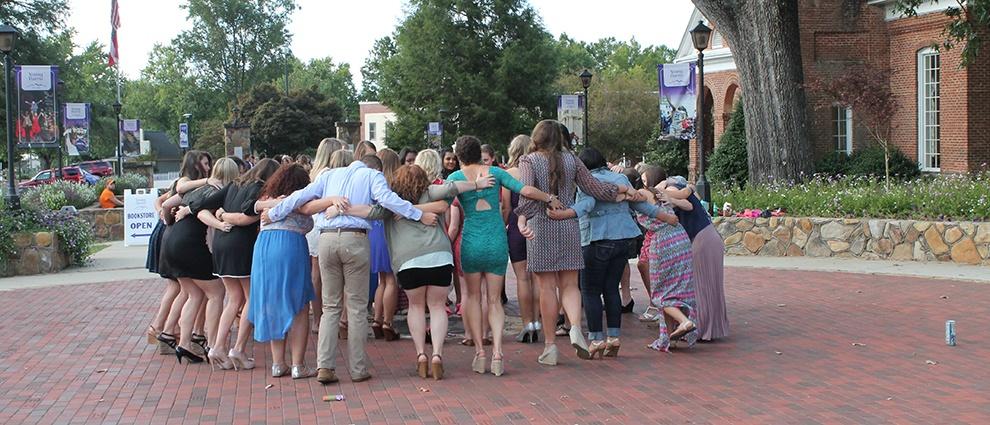 students interlocking arms
