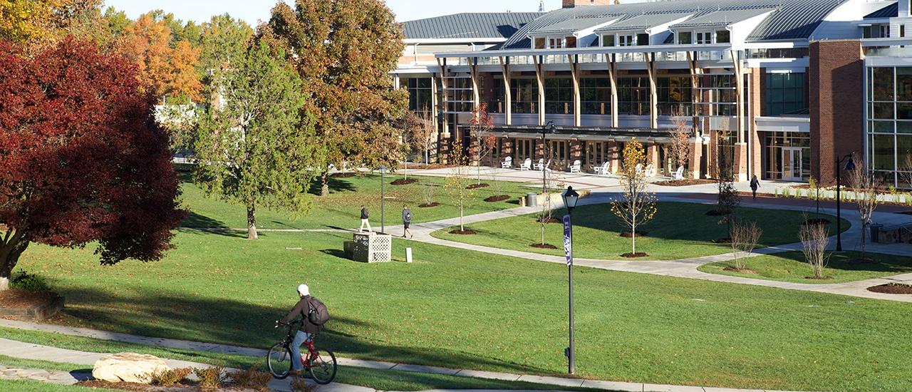 student biking around campus