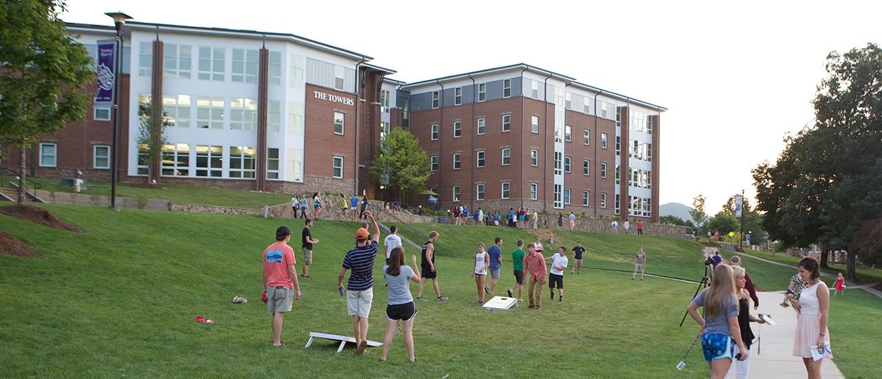 students playing corn hole